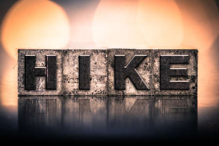 hitch hiker: The word HIKE written in vintage ink stained letterpress type.