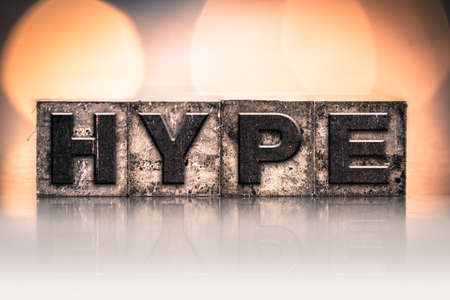 hype: The word HYPE written in vintage ink stained letterpress type.
