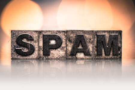 solicitation: The word SPAM written in vintage ink stained letterpress type.