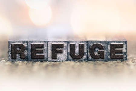 refuge: The word REFUGE written in vintage ink stained letterpress type. Stock Photo