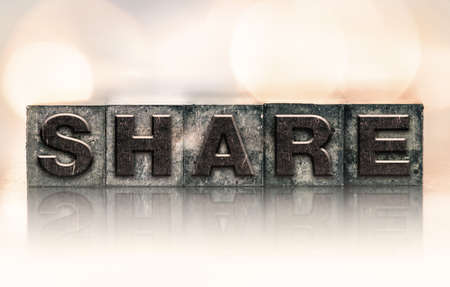 shared sharing: The word SHARE written in vintage ink stained letterpress type.