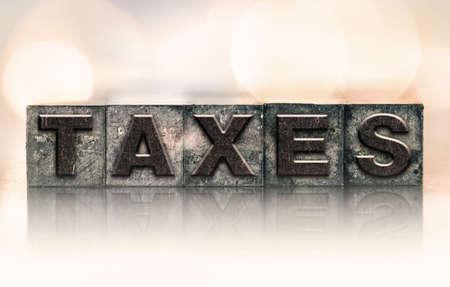 letterpress type: The word TAXES written in vintage ink stained letterpress type.