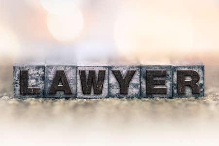 letterpress: The word LAWYER written in vintage ink stained letterpress type.