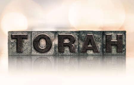 talmud: The word TORAH written in vintage ink stained letterpress type.