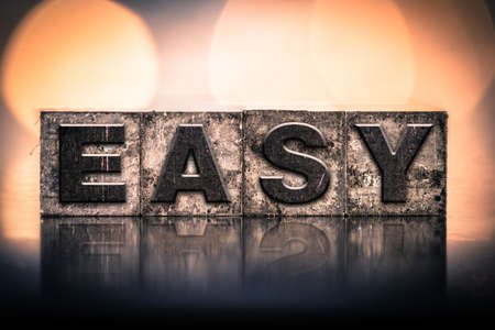 easygoing: The word EASY written in vintage ink stained letterpress type.