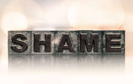 remorse: The word SHAME written in vintage ink stained letterpress type. Stock Photo