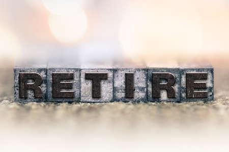 retire: The word RETIRE written in vintage ink stained letterpress type.