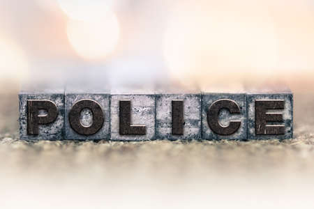 constable: The word POLICE written in vintage ink stained letterpress type.