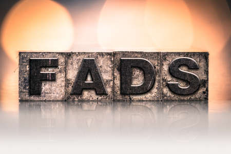 craze: The word FADS written in vintage ink stained letterpress type.