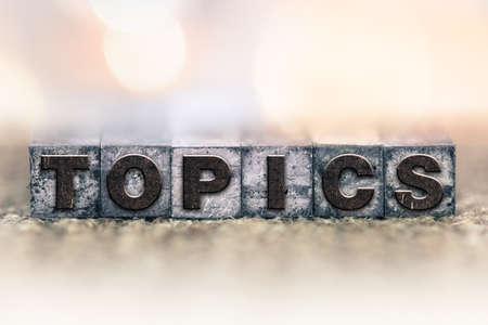 topics: The word TOPICS written in vintage ink stained letterpress type. Stock Photo