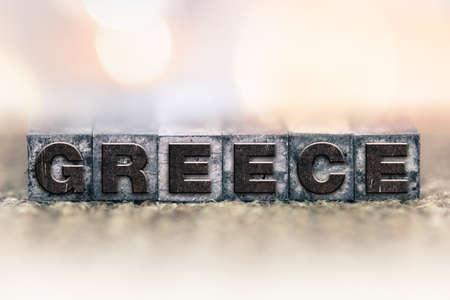 letterpress type: The word GREECE written in vintage ink stained letterpress type.
