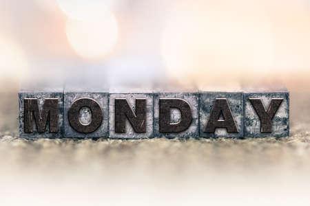 letterpress type: The word MONDAY written in vintage ink stained letterpress type.