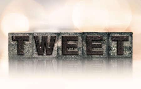 tweet: The word TWEET written in vintage ink stained letterpress type. Stock Photo