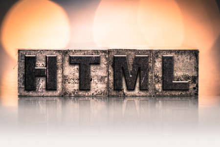 html: The word HTML written in vintage ink stained letterpress type.