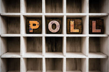 poll: The word POLL written in vintage ink stained wooden letterpress type in a partitioned printers drawer. Stock Photo