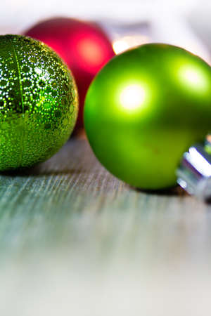 room for copy: A wooden background containing red and green Christmas holiday ornaments. Room for copy. Stock Photo