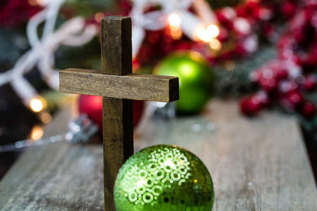 christmas cross: A wooden christmas cross with Christmas decorations.