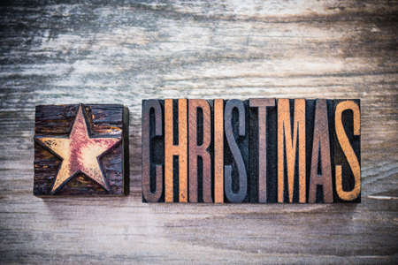 letterpress letters: The word Christmas and star written in vintage wooden letterpress letters.