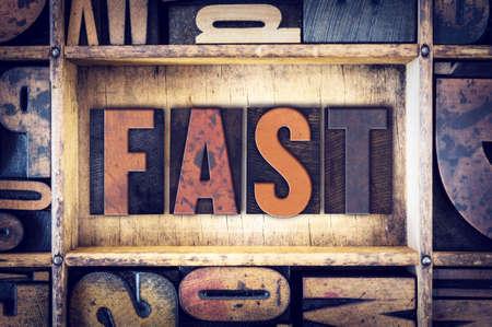 letterpress type: The word Fast written in vintage wooden letterpress type. Stock Photo