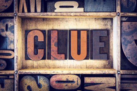 clue: The word Clue written in vintage wooden letterpress type.