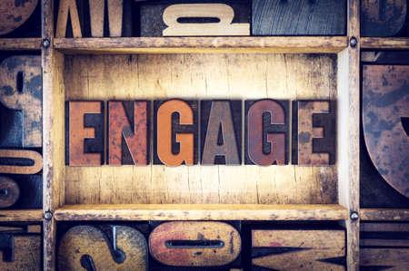 partake: The word Engage written in vintage wooden letterpress type.