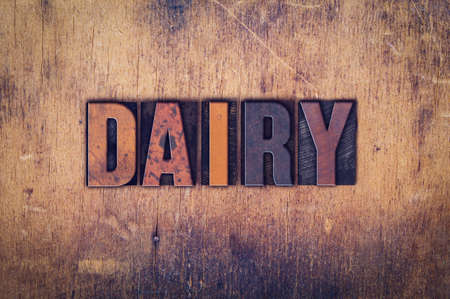intolerant: The word Dairy written in dirty vintage letterpress type on a aged wooden background. Stock Photo