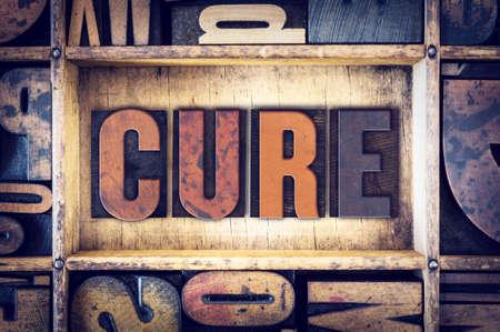 holistic health: The word Cure written in vintage wooden letterpress type.