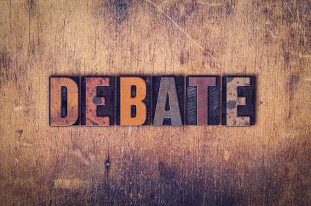rebuttal: The word Debate written in dirty vintage letterpress type on a aged wooden background.