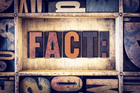 The word Fact written in vintage wooden letterpress type.