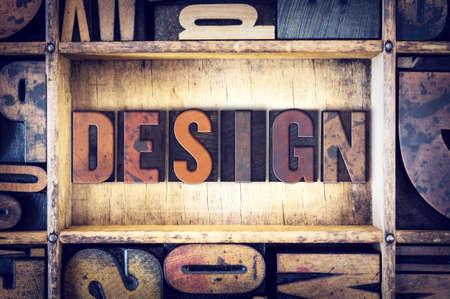 The word Design written in vintage wooden letterpress type.