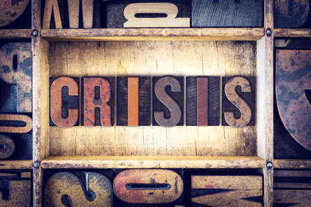 letterpress type: The word Crisis written in vintage wooden letterpress type. Stock Photo