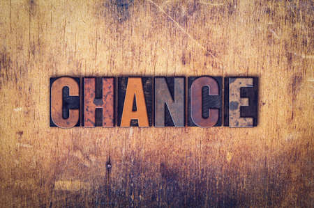 unplanned: The word Chance written in dirty vintage letterpress type on a aged wooden background. Stock Photo