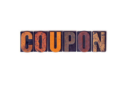 sunday paper: The word Coupon written in isolated vintage wooden letterpress type on a white background.