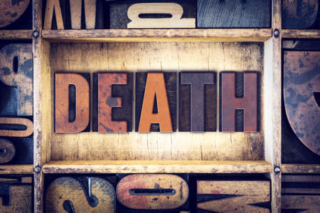 obituary: The word Death written in vintage wooden letterpress type. Stock Photo