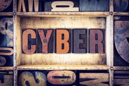 letterpress type: The word Cyber written in vintage wooden letterpress type. Stock Photo