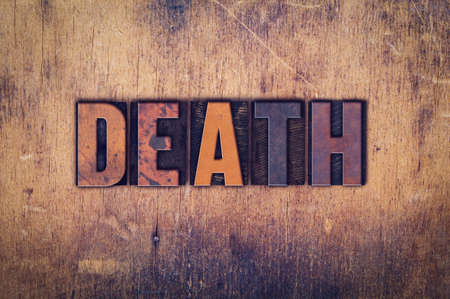 pass away: The word Death written in dirty vintage letterpress type on a aged wooden background. Stock Photo