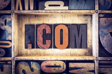 dot com: The word Dot Com written in vintage wooden letterpress type. Stock Photo