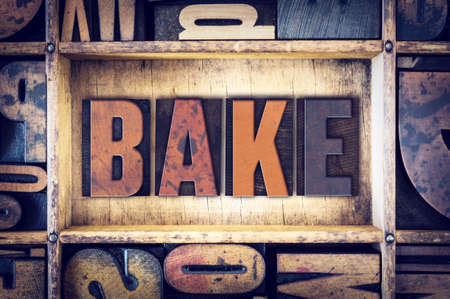 letterpress type: The word Bake written in vintage wooden letterpress type.