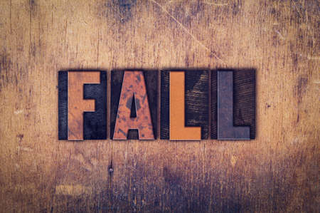 slump: The word Fall written in dirty vintage letterpress type on a aged wooden background. Stock Photo