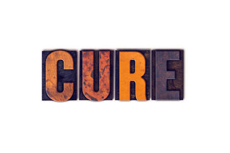 clinical trial: The word Cure written in isolated vintage wooden letterpress type on a white background.
