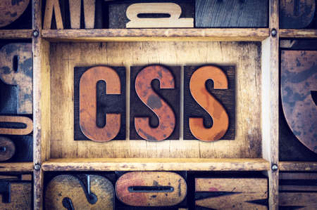 css: The word CSS written in vintage wooden letterpress type. Stock Photo
