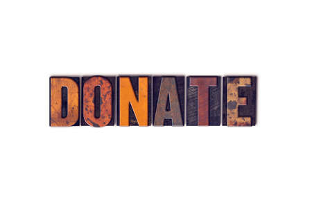 The word Donate written in isolated vintage wooden letterpress type on a white background.