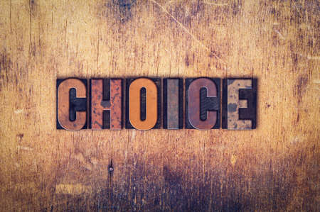 The word Choice written in dirty vintage letterpress type on a aged wooden background.