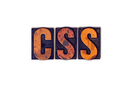 css: The word CSS written in isolated vintage wooden letterpress type on a white background. Stock Photo