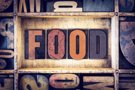 letterpress type: The word Food written in vintage wooden letterpress type.