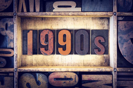 decade: The word 1990s written in vintage wooden letterpress type. Stock Photo