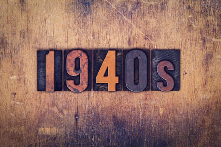 decade: The word 1940s written in dirty vintage letterpress type on a aged wooden background.