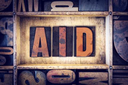 nurture: The word Aid written in vintage wooden letterpress type.