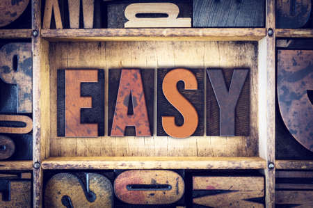 easygoing: The word Easy written in vintage wooden letterpress type. Stock Photo