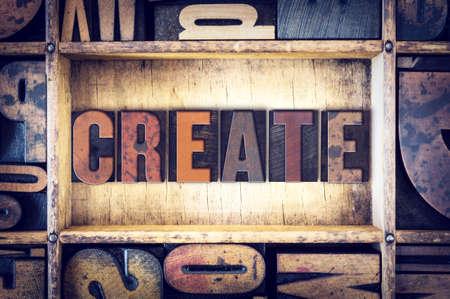 The word Create written in vintage wooden letterpress type.